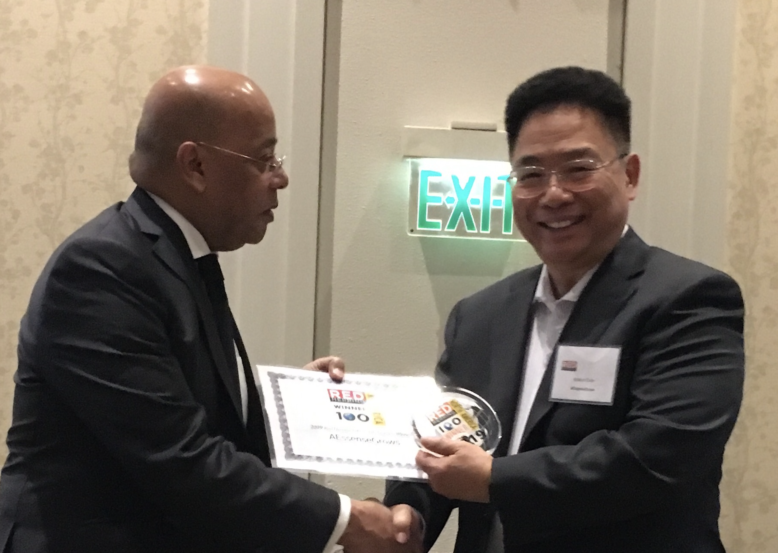 CEO Robert Chen receiving the award.  Photo provided by   AEssenseGrows