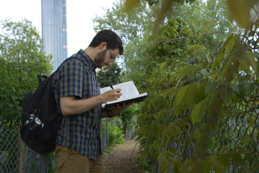 Graduate student Jared Kaufman (MET) during a class tour of the Fenway Victory Gardens. Photo by Jason Kimball