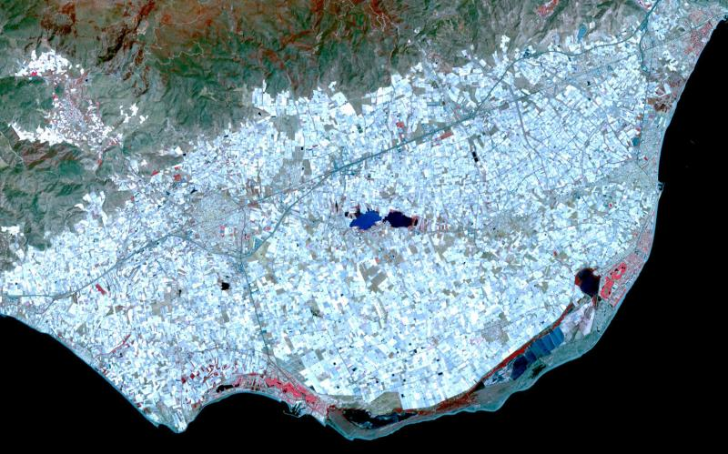 Image: NASA/GSFC/METI/ERSDAC/JAROS, and U.S./Japan ASTER Science Team, Surrounding the town of El Ejido, Almeria Province, southern Spain is a sea of greenhouses, stretching for tens of kilometres.