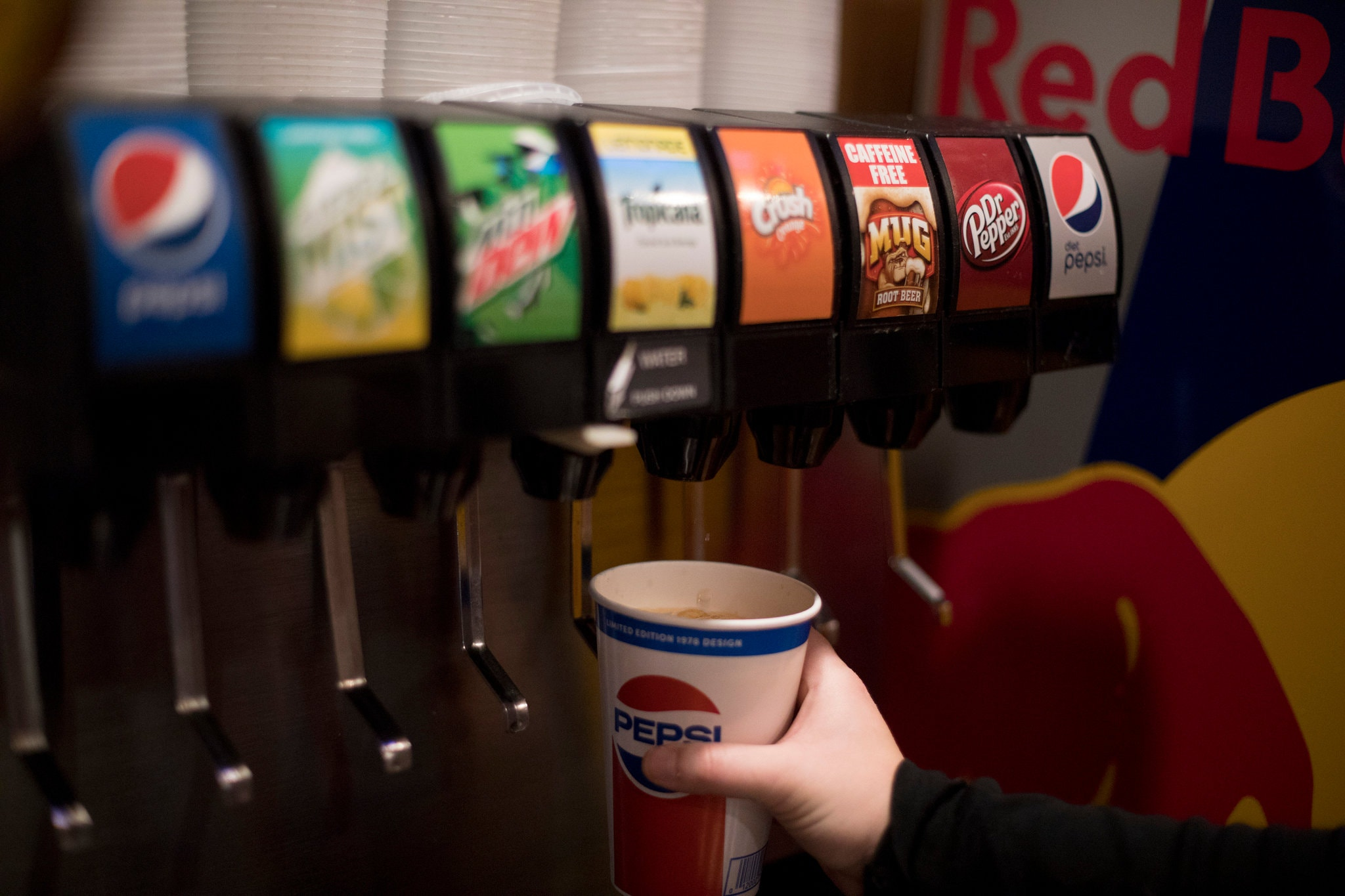 Taxes on sugary beverages and junk food would help lower health care costs. Credit: Jenny Kane/Associated Press