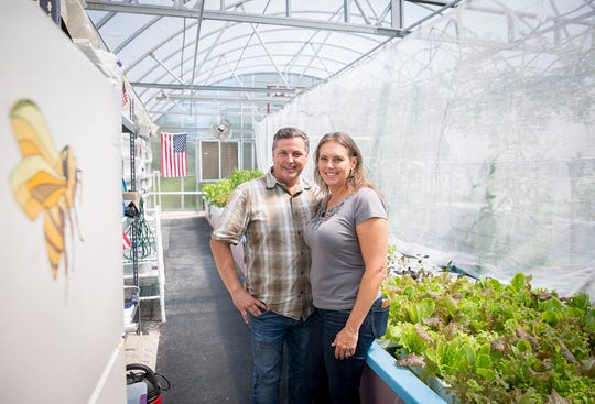 Glynn and Kellie Barber stand in a client's greenhouse in Daleville.     (Photo: Jordan Kartholl/The Star Press)