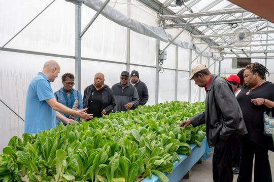 Members of a Gary church visits the Teen Challenge ECSIA greenhouse in Elkhart.  (Photo: Photo provided)