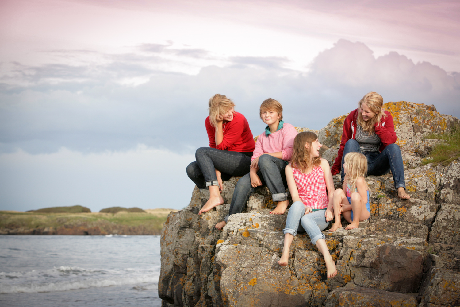 5 children and teens on the rocks at North Berwick