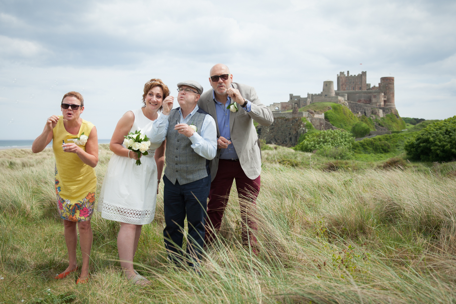 wedding-bamburgh-pictorial-elopement-friends-beach-0974.jpg