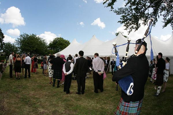 Scottish piper entertaining wedding guests