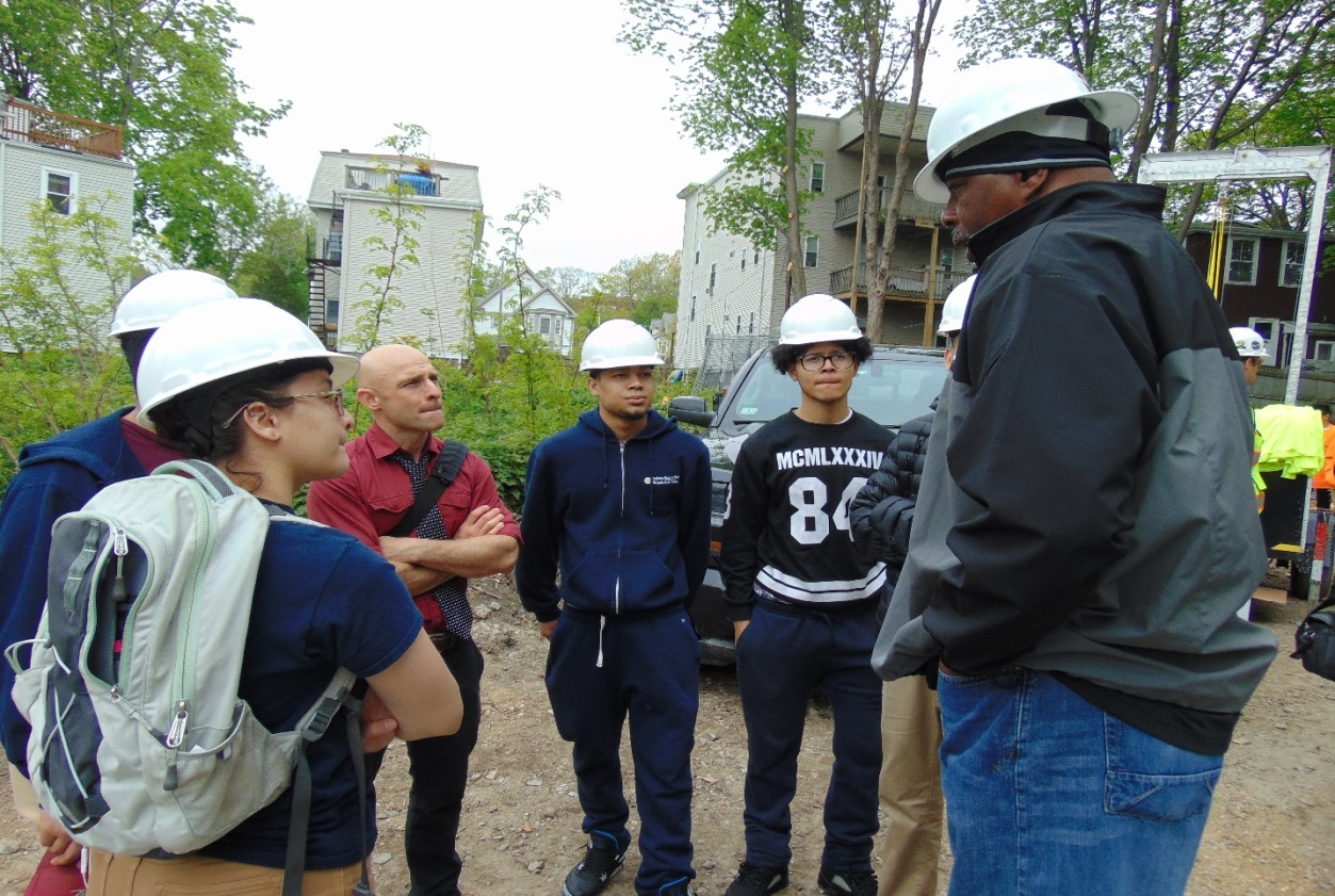 Charles Cofield (on the far right), member of the Carpenters Union, Local 327, talking to a group of students from the Margarita Muniz Academy.