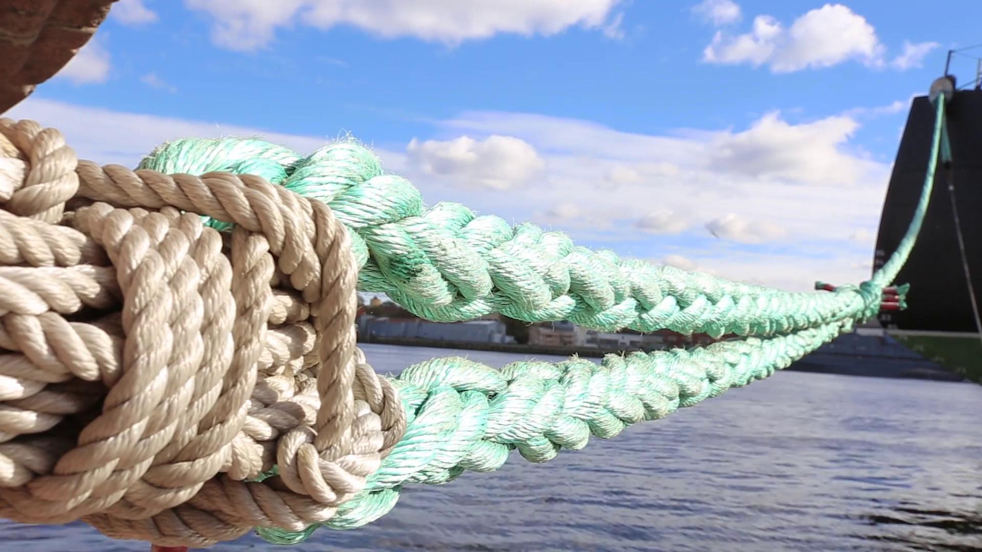 ship-mooring-ropes-hd-the-ship-is-at-berth_rxi3ujtvg_thumbnail-full01.png