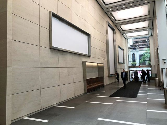 """645 5th Avenue, NYC Lobby Renovation featuring Moca Creme 6"""" thick wall panels and Basaltite and Caldia floor pavers. This is a public lobby so feel free to swing through there to check out our work!"""