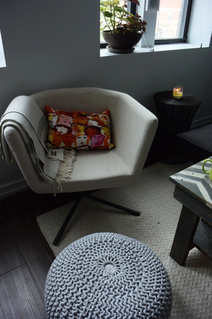 I've always wanted to own one of these  knit poufs  from CB2 - & now I finally do! We went with the light grey so that it doesn't distract from statement pillows like this awesome face one (unfortunately I have no idea where that pillow is from - it's several years old!).