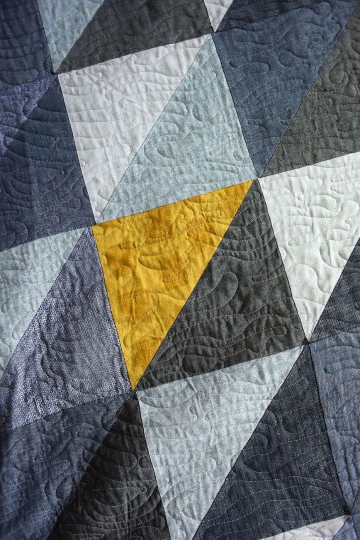 My mom made Grayson & I THE BEST quilt - it's mainly blue/gray denim & chambray triangle/squares but the back is the most awesome mustard yellow cat fabric & she threw it on one of the front triangles as well. Once I finally complete all the pillows that will go on our bed, this baby will get its own Color Inspiration post!