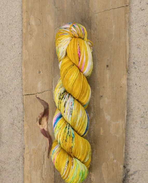Fool's Gold by Hedgehog Fibres is a forever favorite. The first time I saw it, I knew I wanted every skein in existence. It's so striking & unique, & such a great blend of yellow & other hues! Photo by  Wool & Honey .
