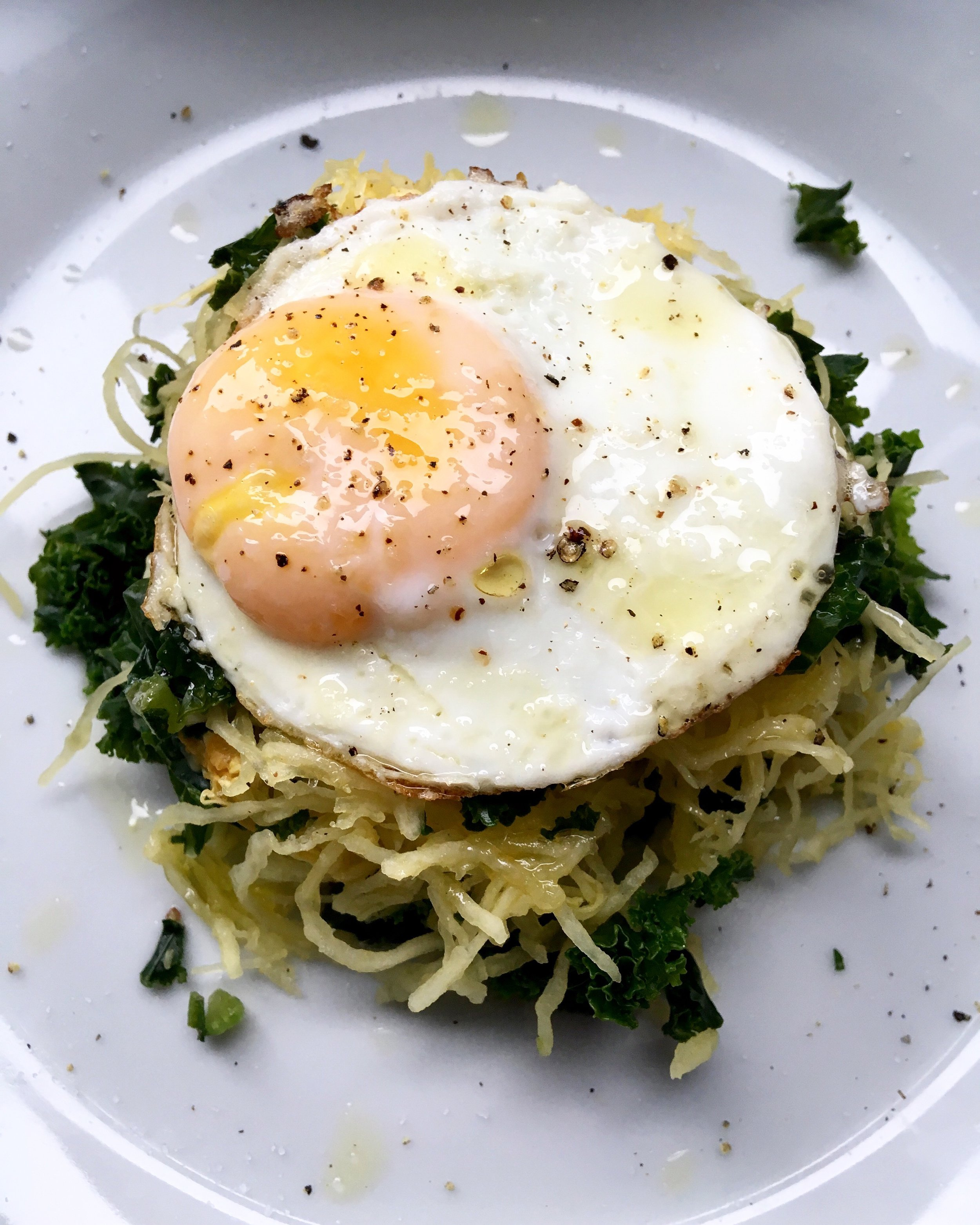 roasted spaghetti squash + kale nest with sunny side up egg