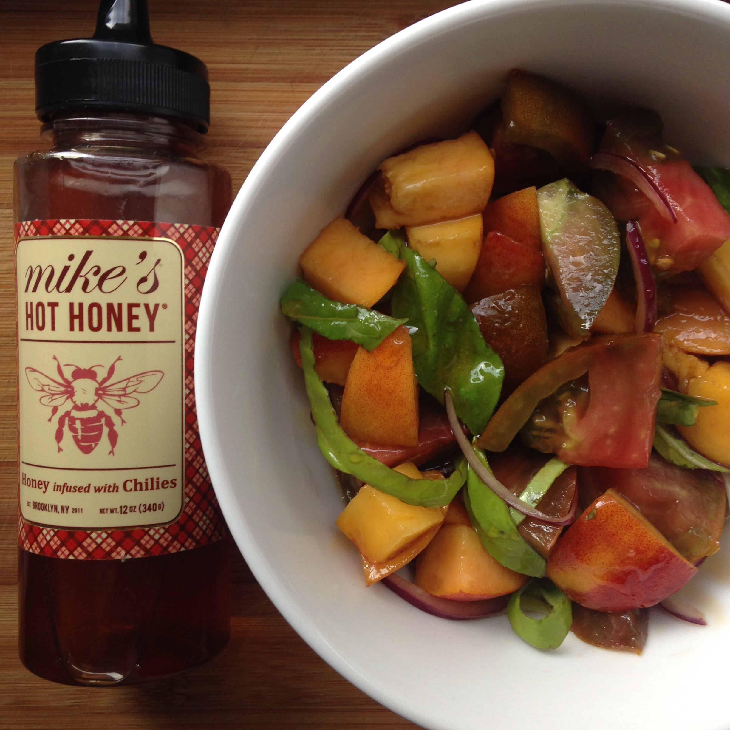 peach + heirloom salad with hot honey dressing