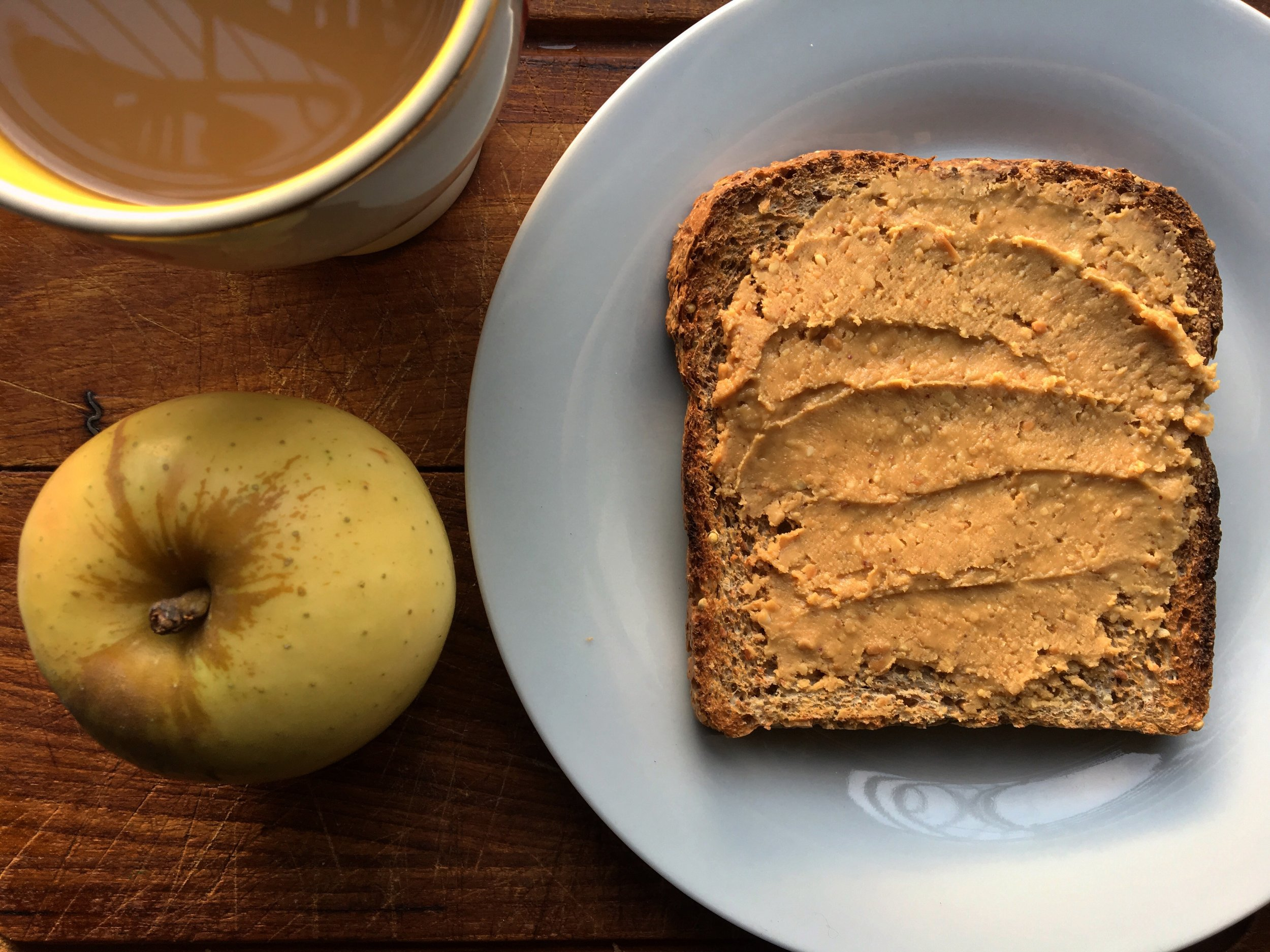 morning minimalism: freshly ground peanut butter on sprouted bread