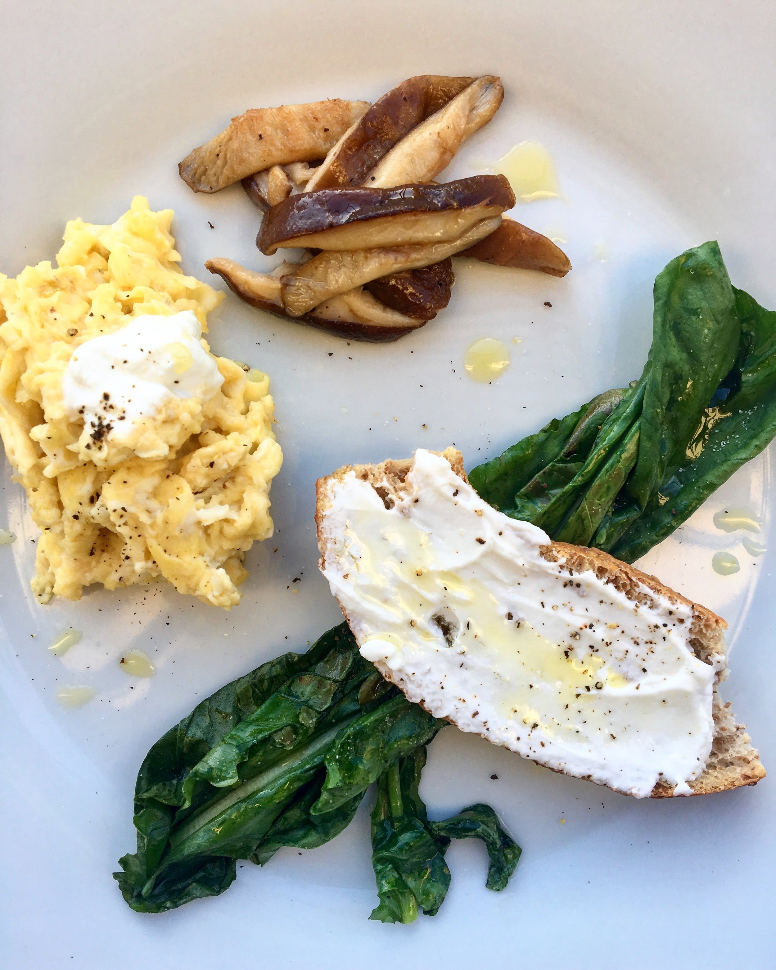 mascarpone scrambled eggs, brown butter shiitake mushrooms, wilted arugula  + truffle oil