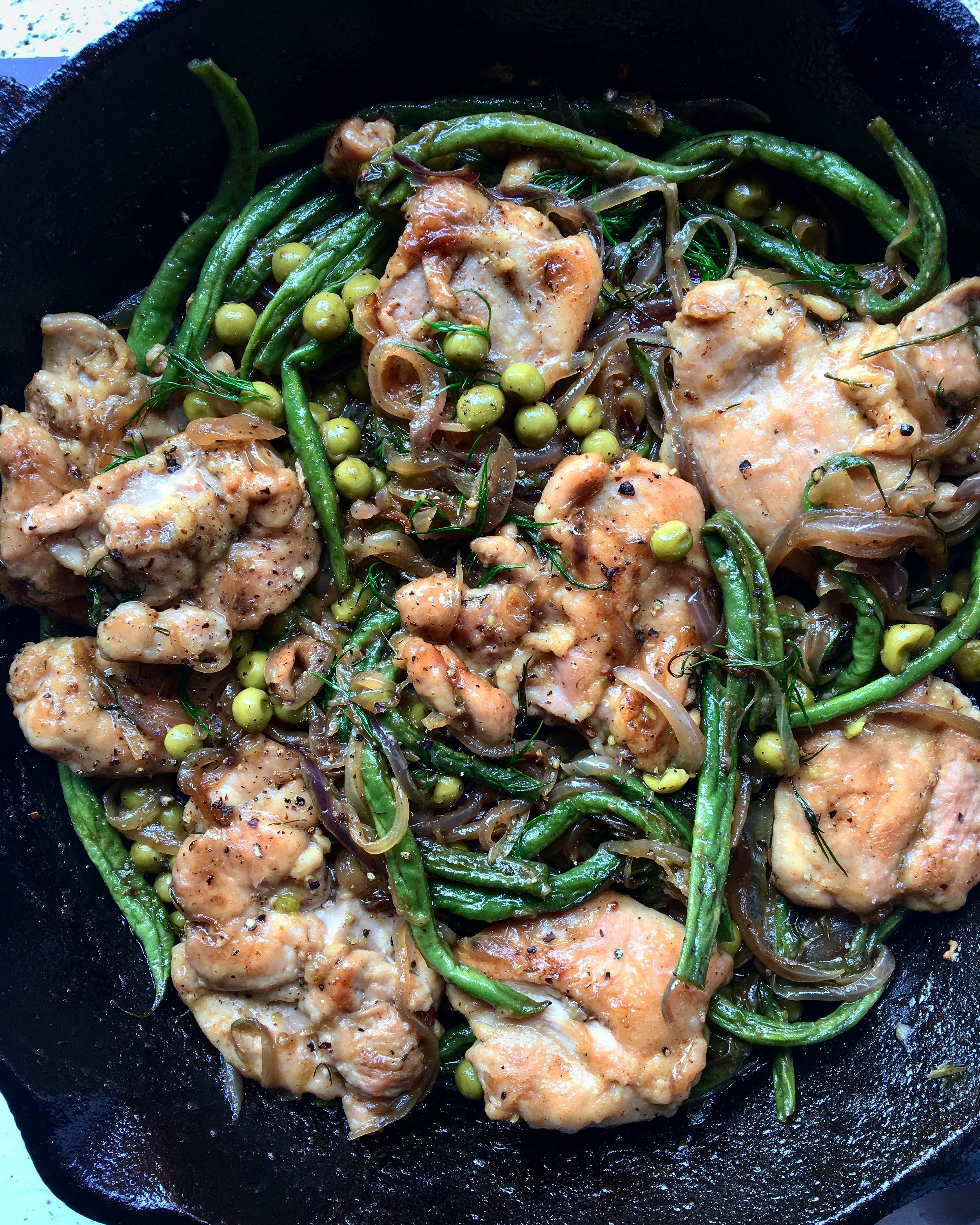 chicken thighs with onions, string beans + peas in a sherry wine, butter + dill sauce