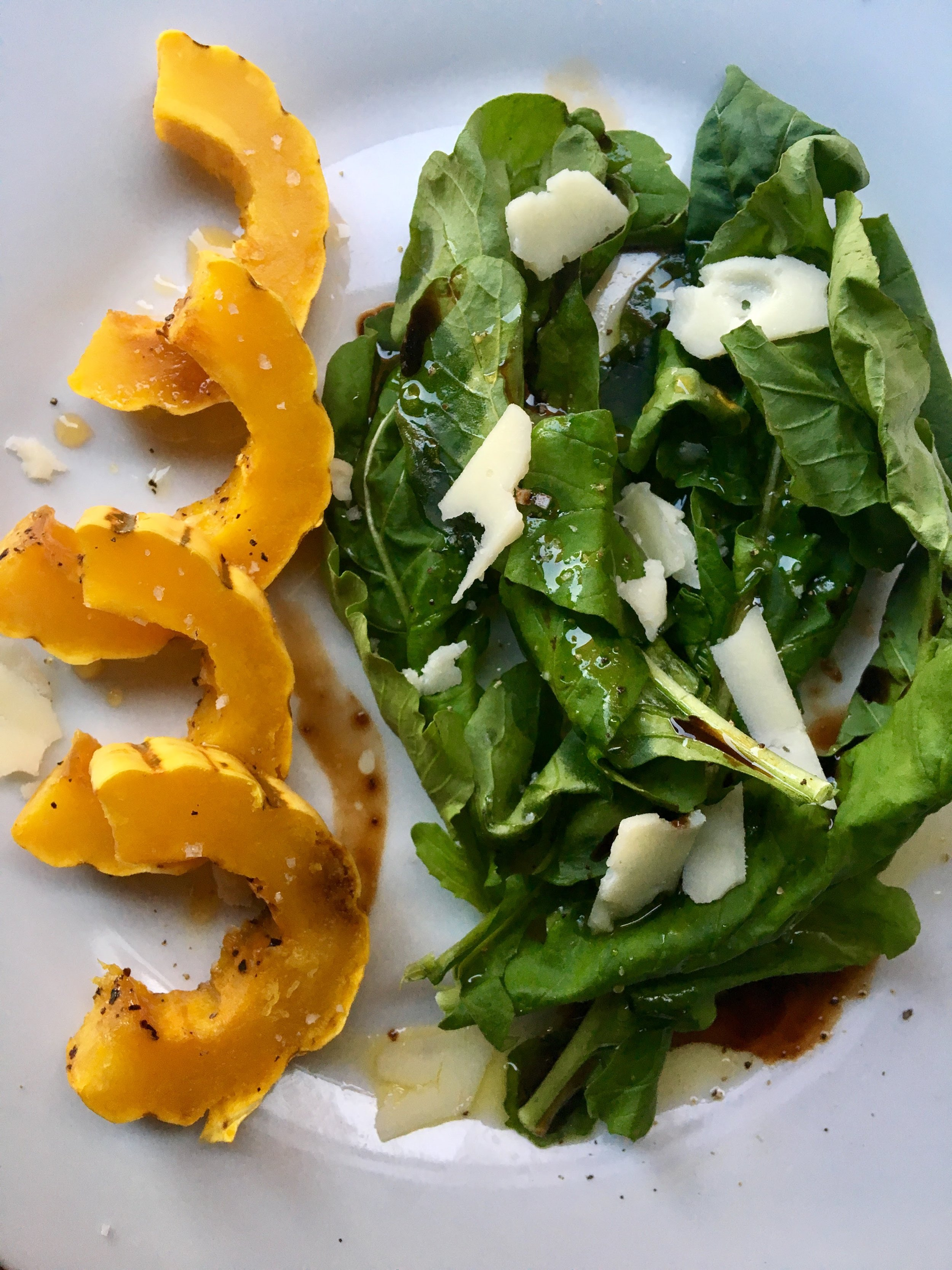 maple glazed delicata squash with arugula, balsamic vinaigrette + provolone
