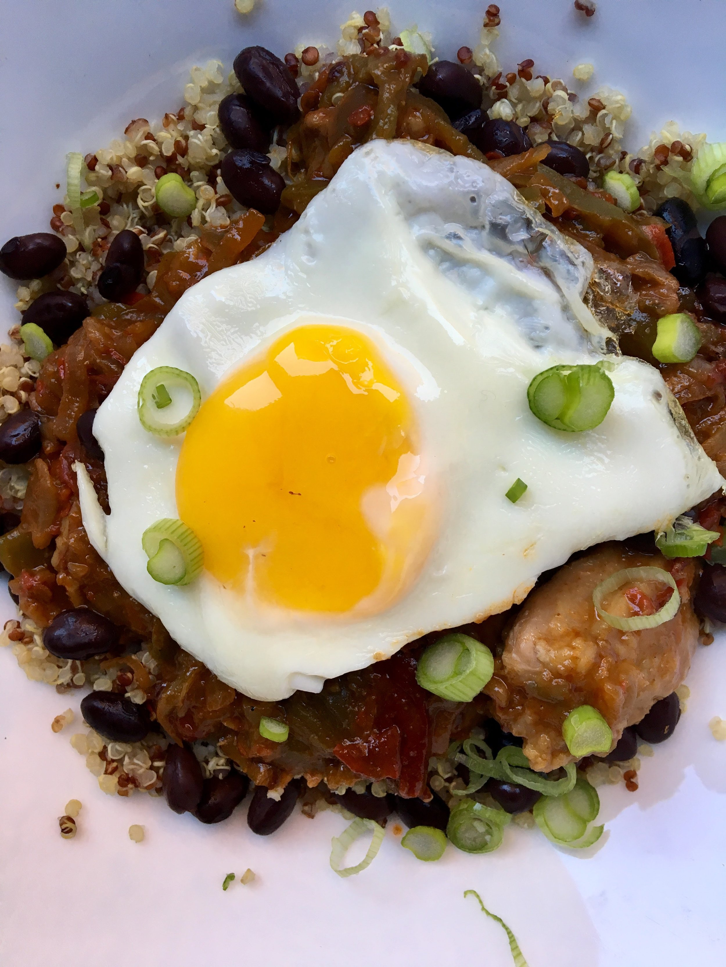 chipotle chicken layered with grains, beans + sunny side egg