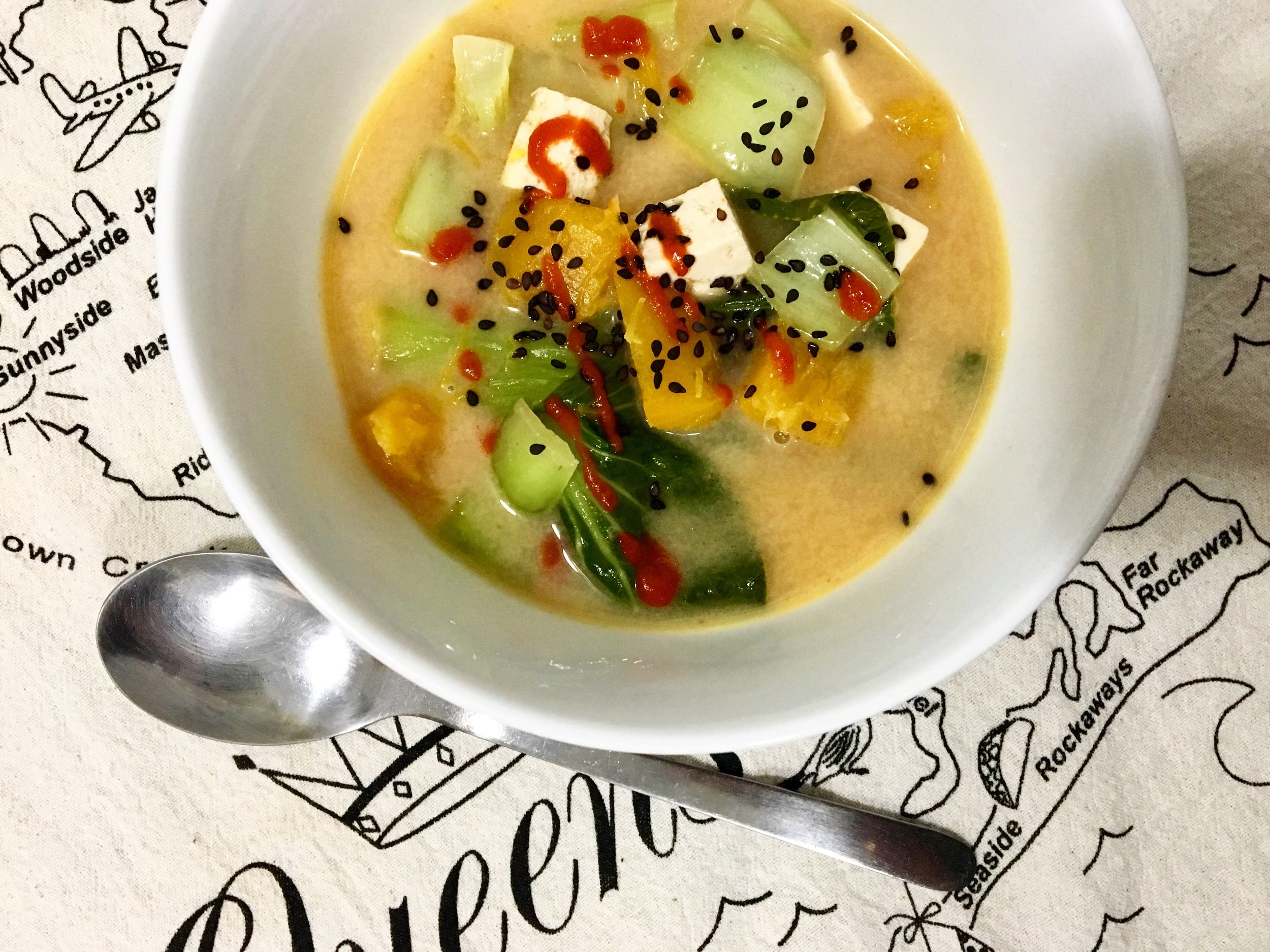 coconut miso soup with pumpkin, tofu + bok choy