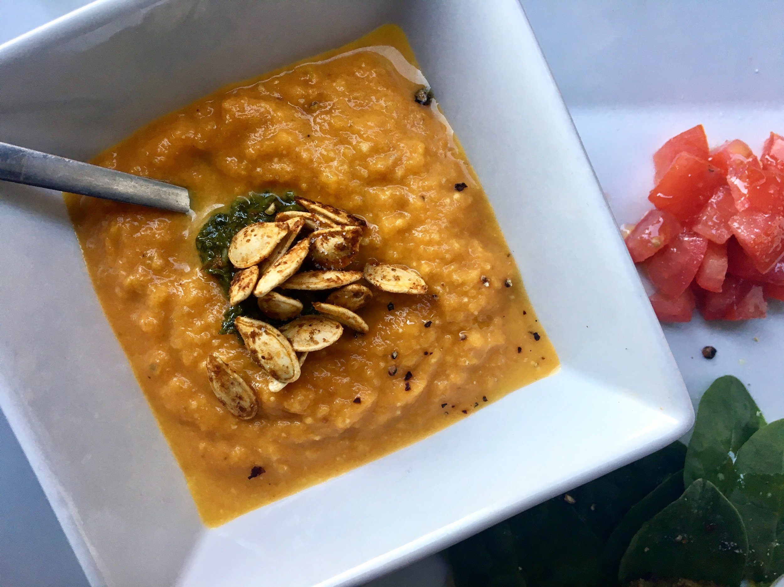 pumpkin soup and green sauce with spiced nuts