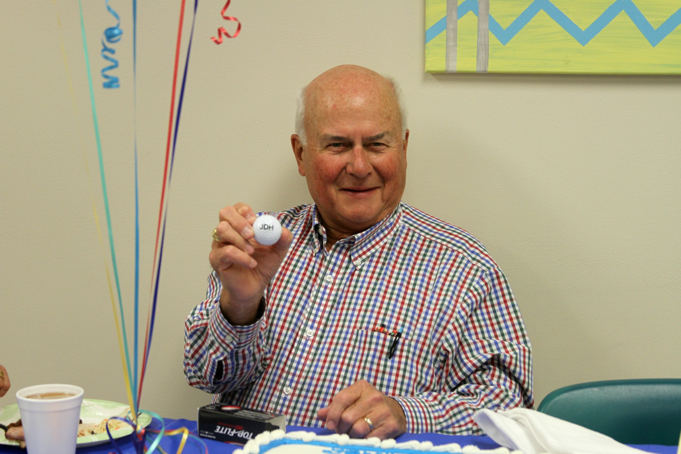 Showing off his new golf balls with his initials.