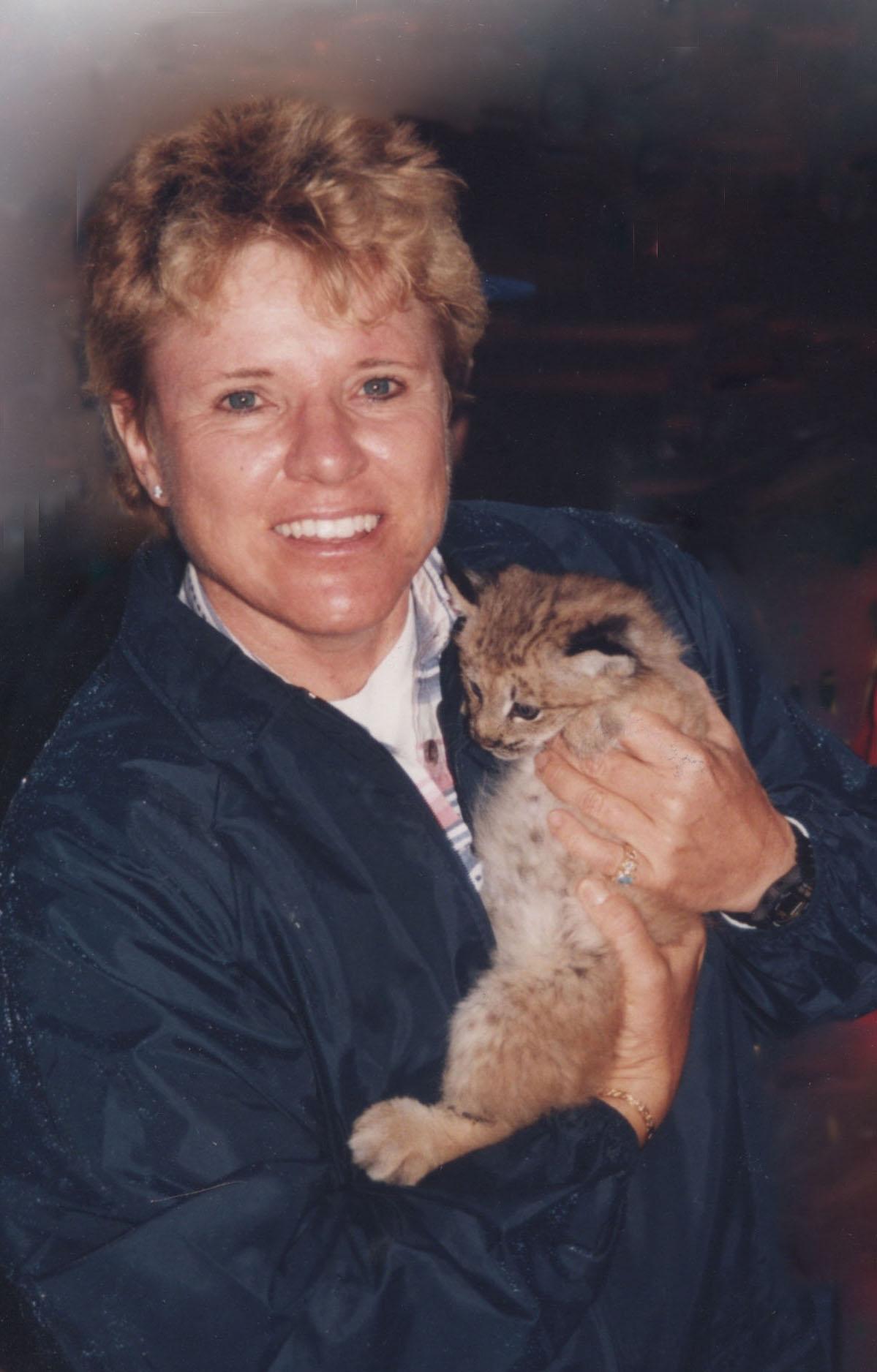 Gabrielle hugging a bobcat kitten