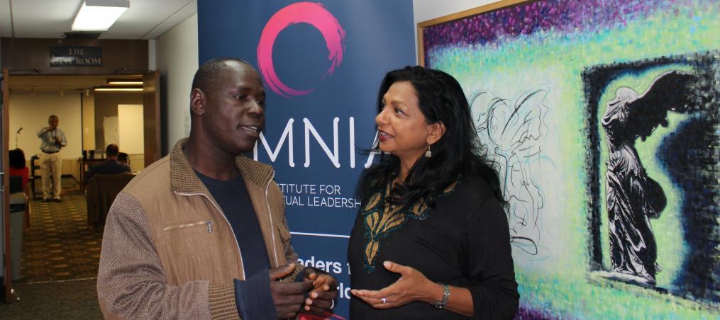 OMNIA Leaders Rev. Abare Kallah and Soraya Deen confer at OMNIA Leadership Summit