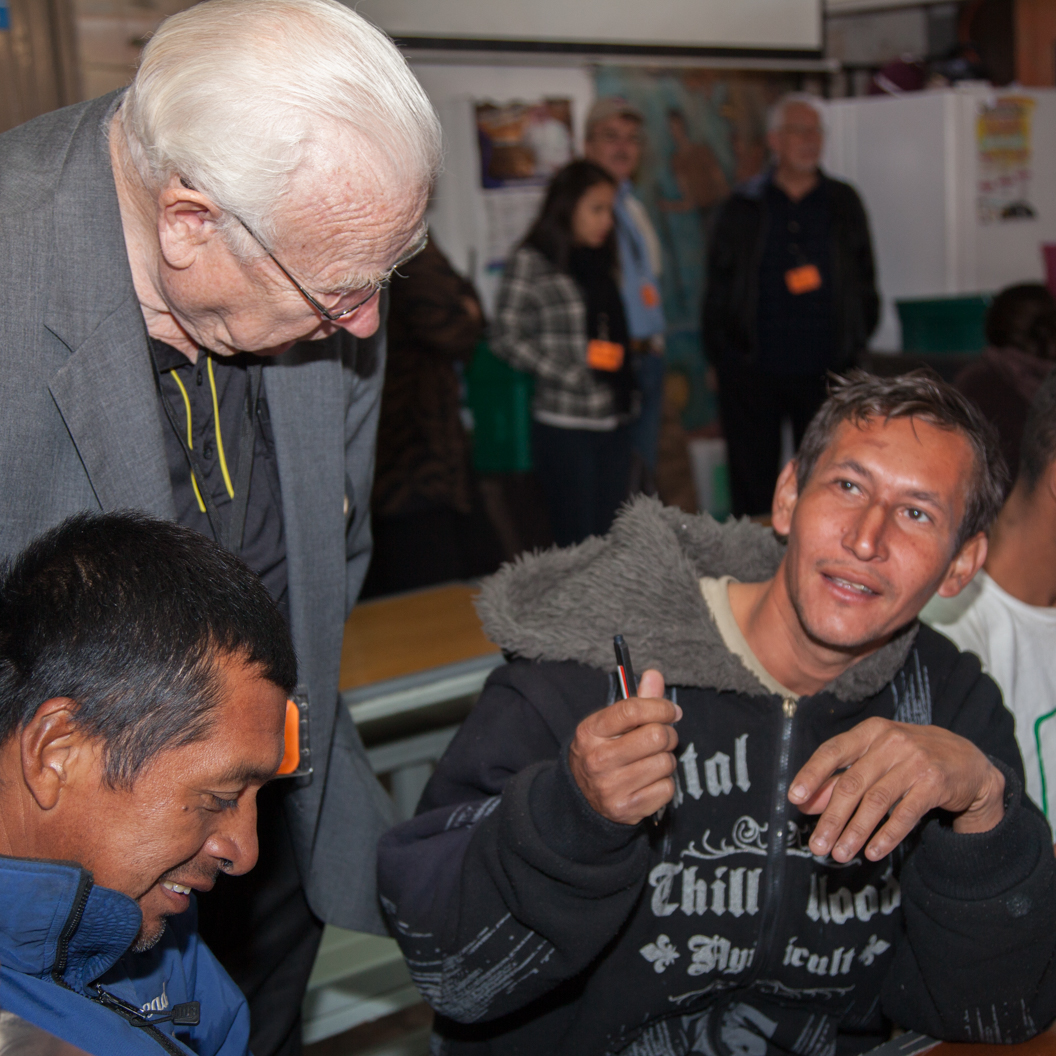 Rev. Dr. Ken Bensen listening to two recently deported persons at a food and medical shelter in Nogales, Mexico.