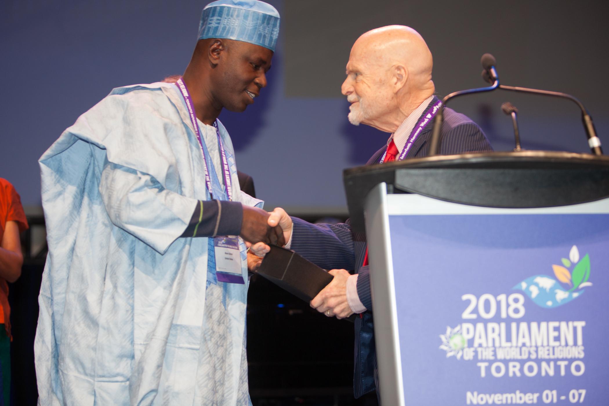 OMNIA's Rev. Abare Kallah receives the Paul Carus Award