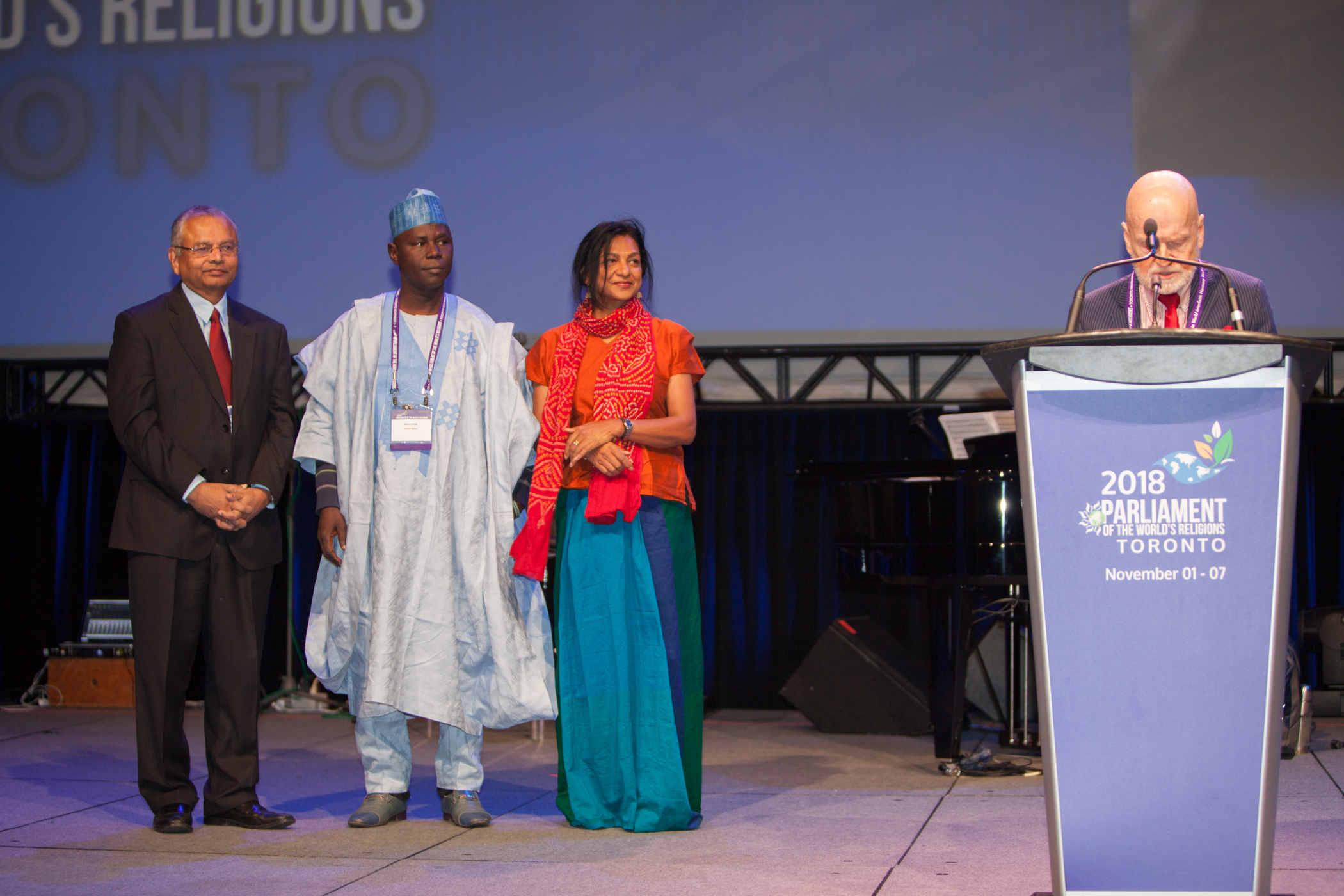 Parliament of the World's Religions President Rev. Larry Greenfield presents Paul Carus Award to OMNIA