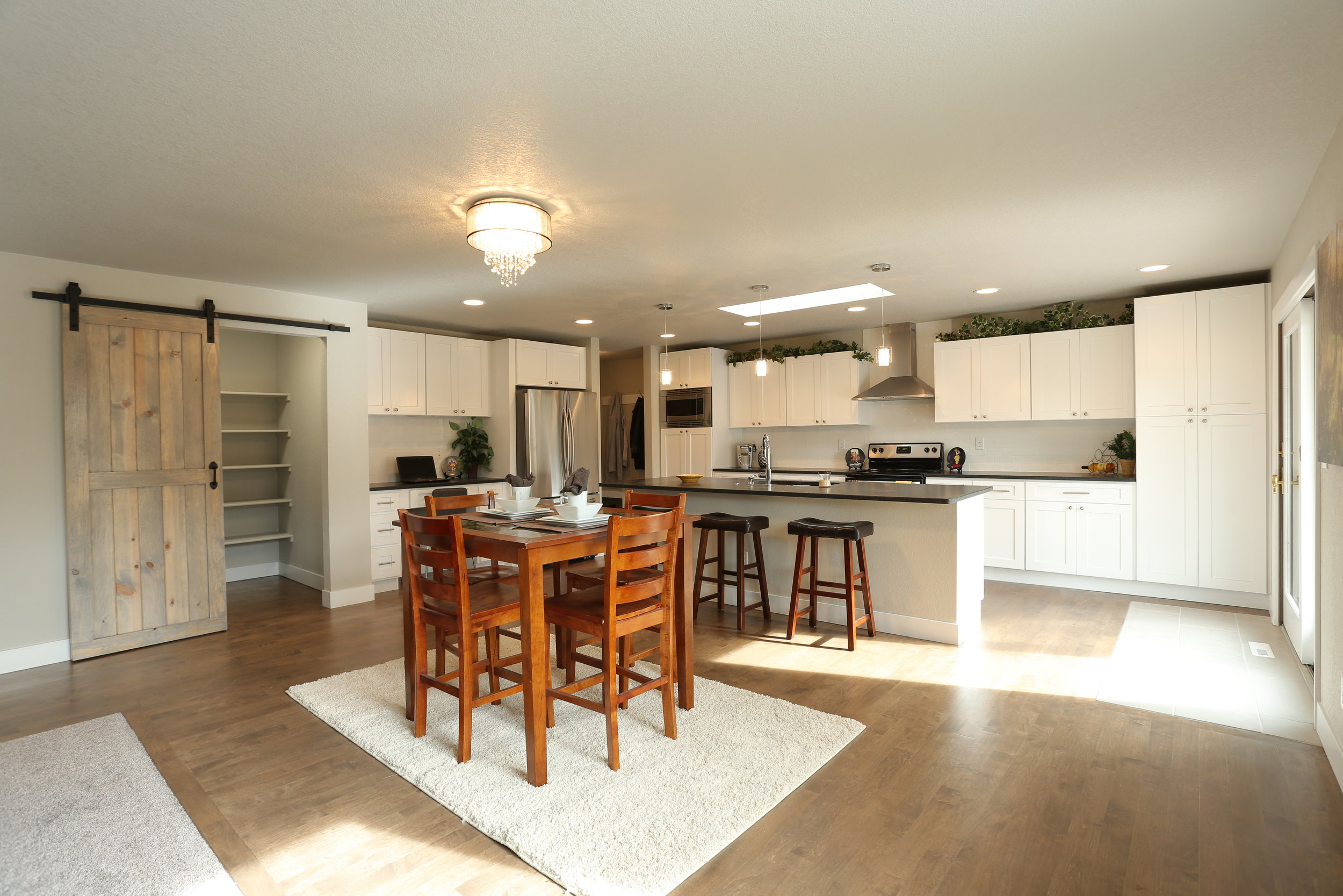 open floor concept with refinished maple wood floors and large kitchen island