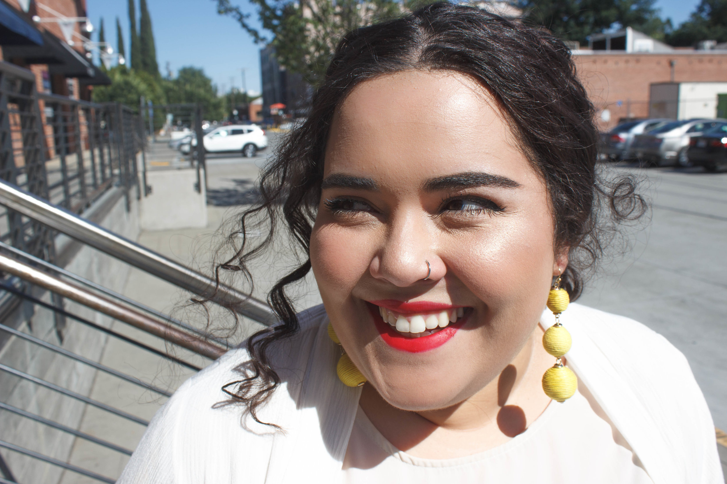 + Yellow pom pom earrings for a pop of color -
