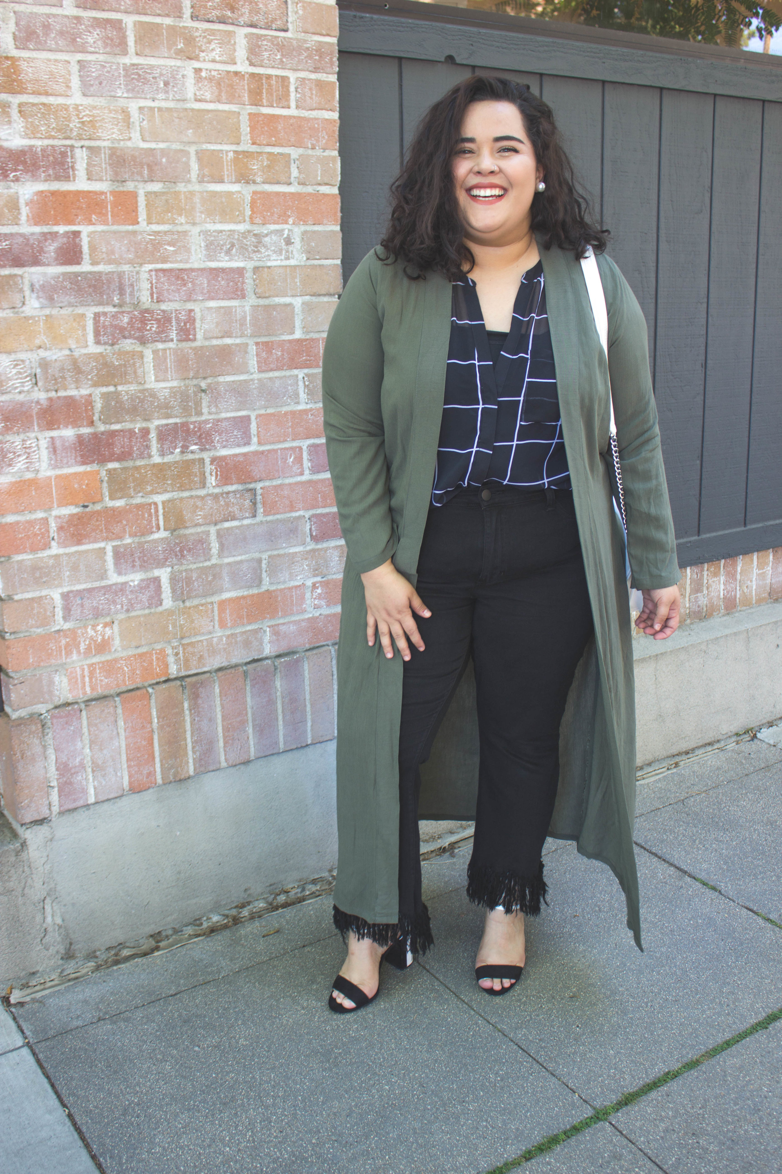An Olive Green Duster+ Perfect contrast color for a black and white look+ White crossbody purse -