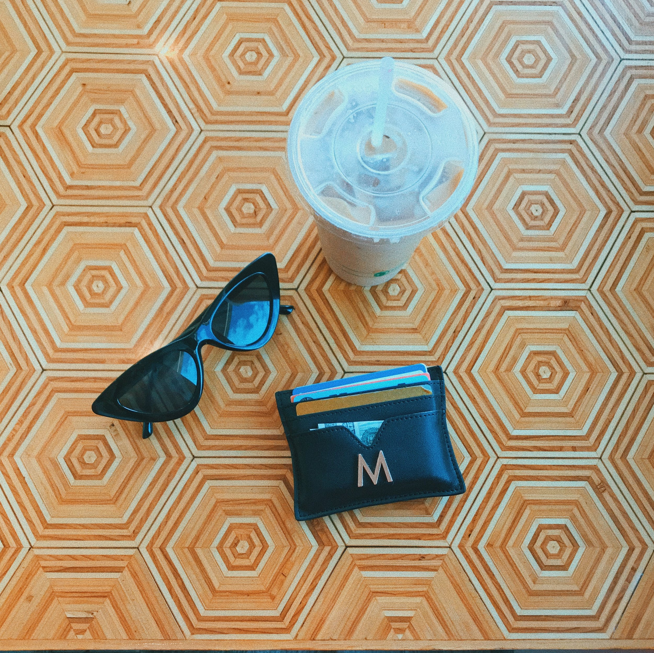 Shop the sunglasses  here  & the wallet  here