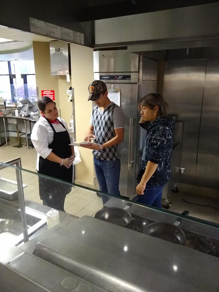 Above are a couple of international students providing the staff with a recipe for a delicious foreign meal, in the UTM cafe.