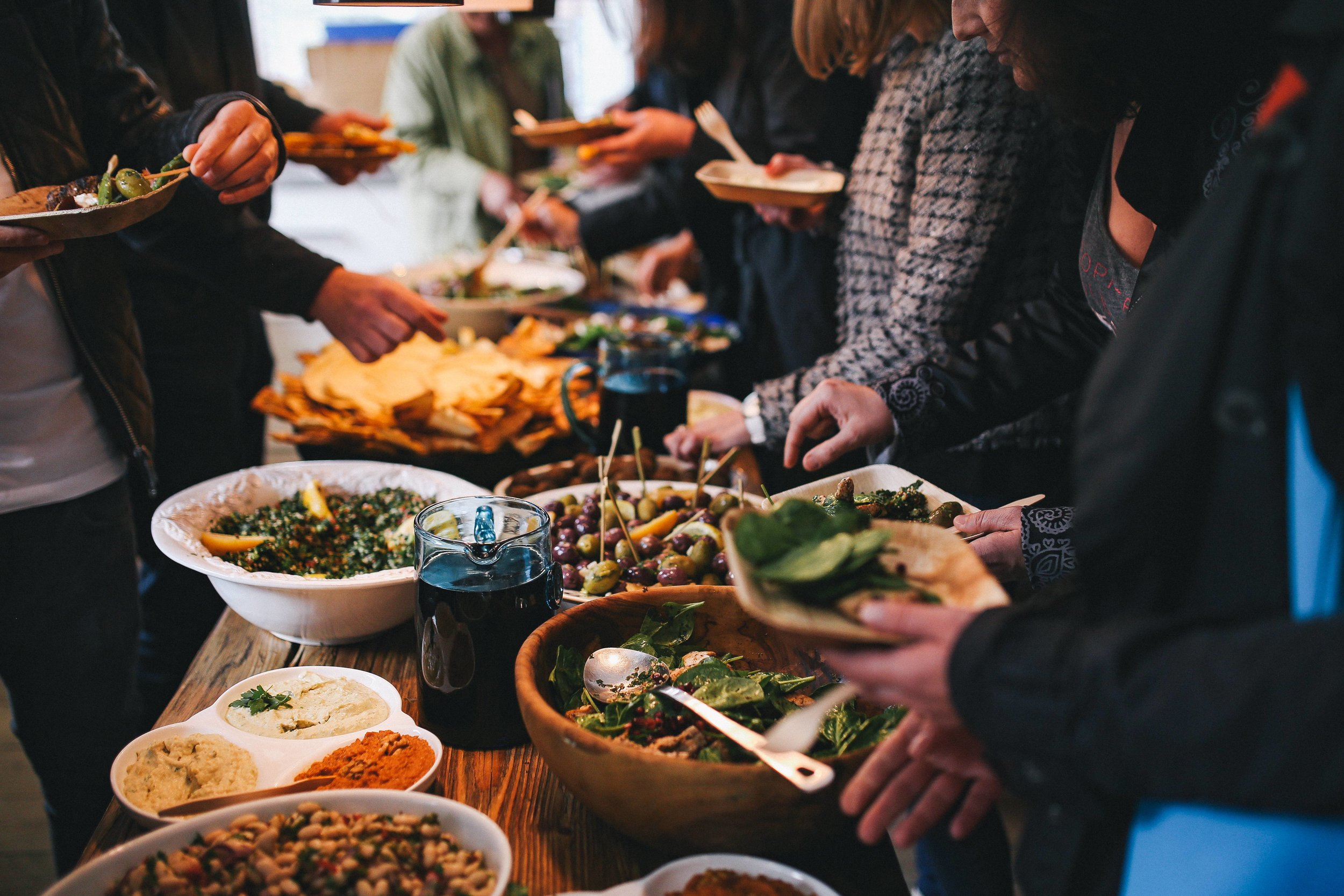 kaboompics_People by a banquet table full with food.jpg