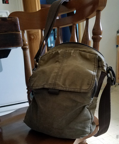 Messenger Bag standing tall in spite of the wear and tear