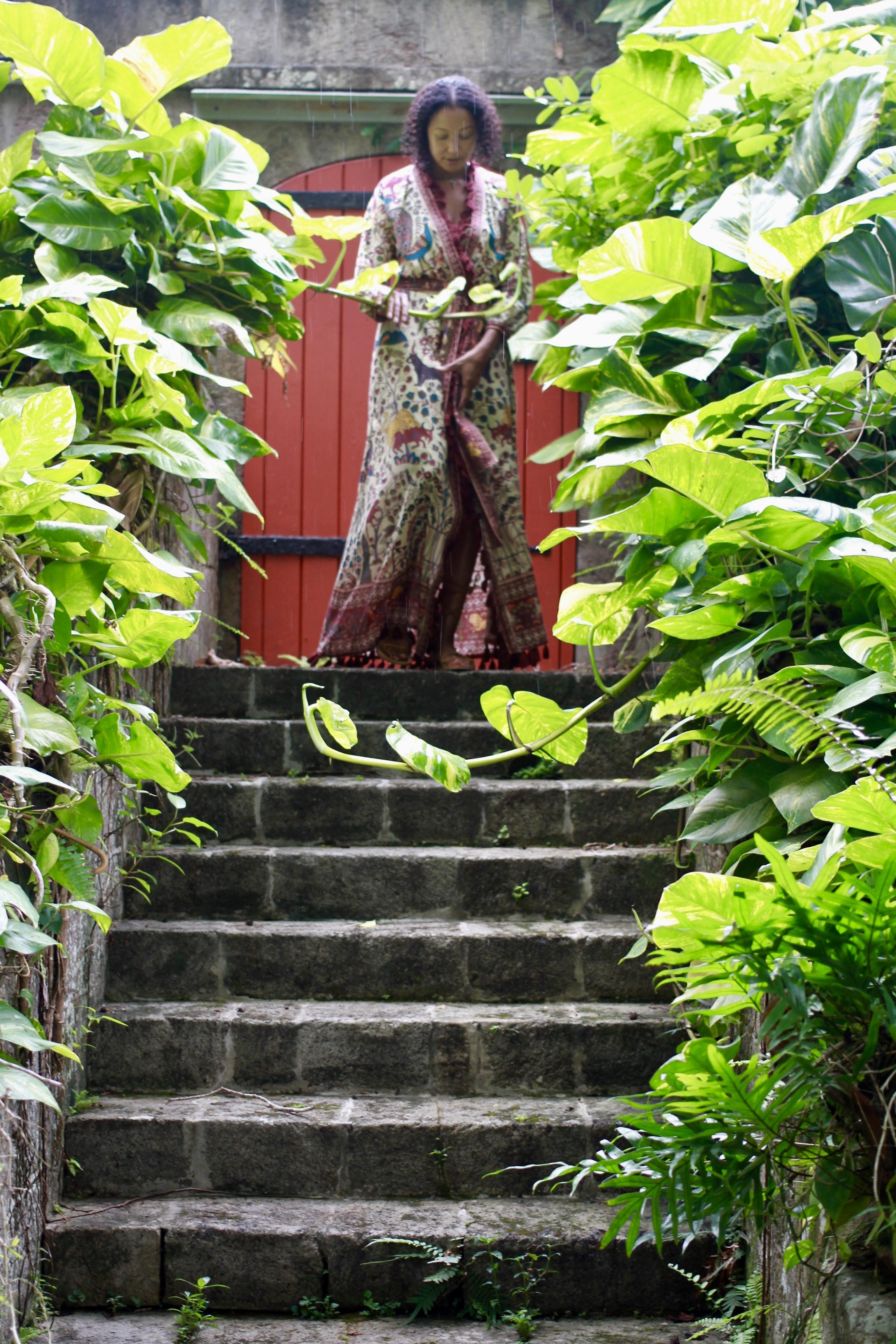 Exploring the gardens at the lovely Golden Rock Inn. Dress by Rhode Resort.