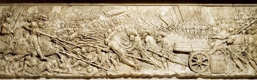 Relief of the Battle of Marignano on the side of the Tomb of Francis I in the Abbey Church, Saint-Denis, France. Francis is to the left on his horse wielding a lance. interesting enough, the enemy did not have cannons although this releif depicts Francis charging into cannons.