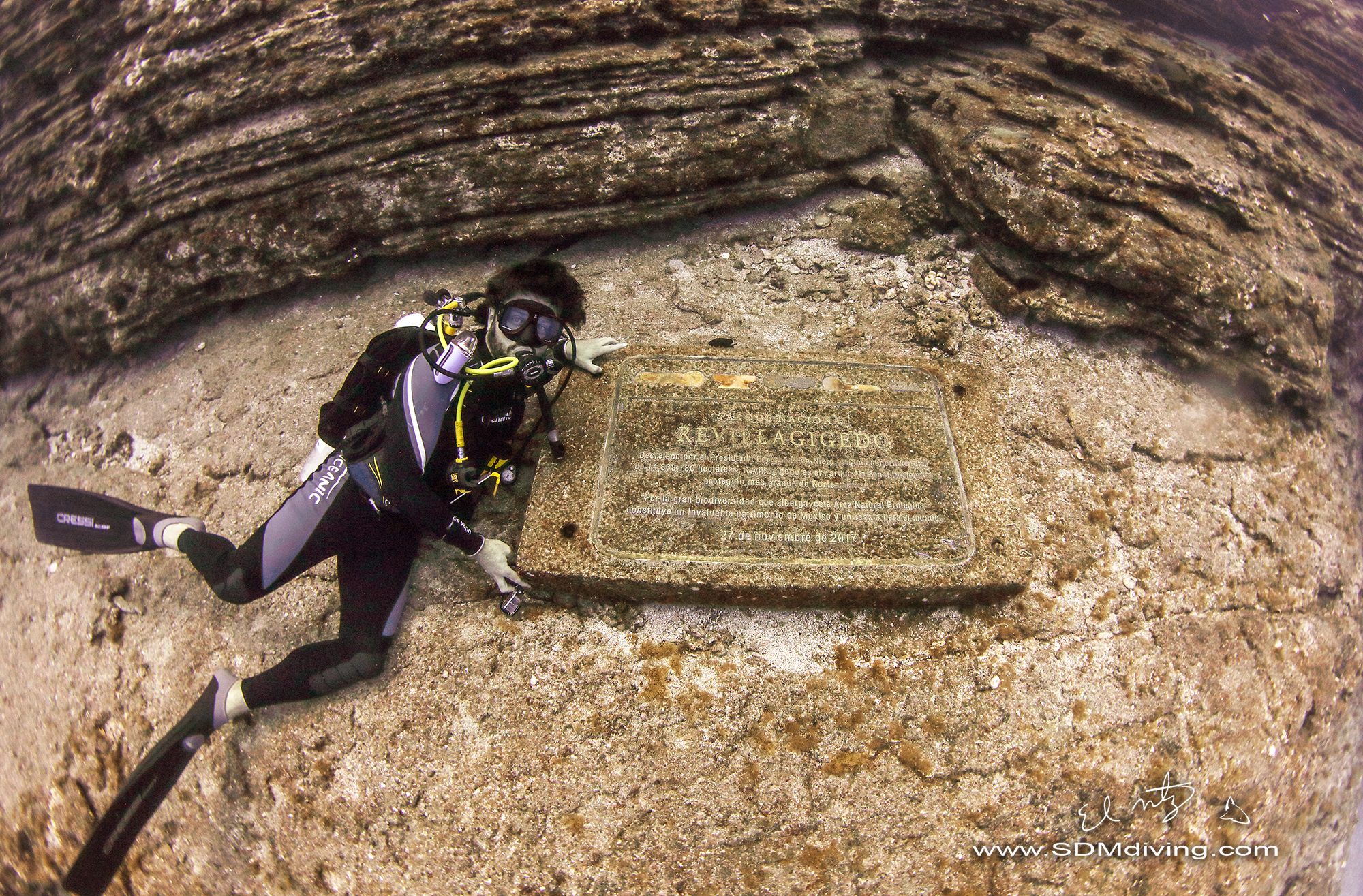 Alex next to a plaque placed at the dive site honoring the UNESCO status. And yup, I took that shot… pretty pumped.