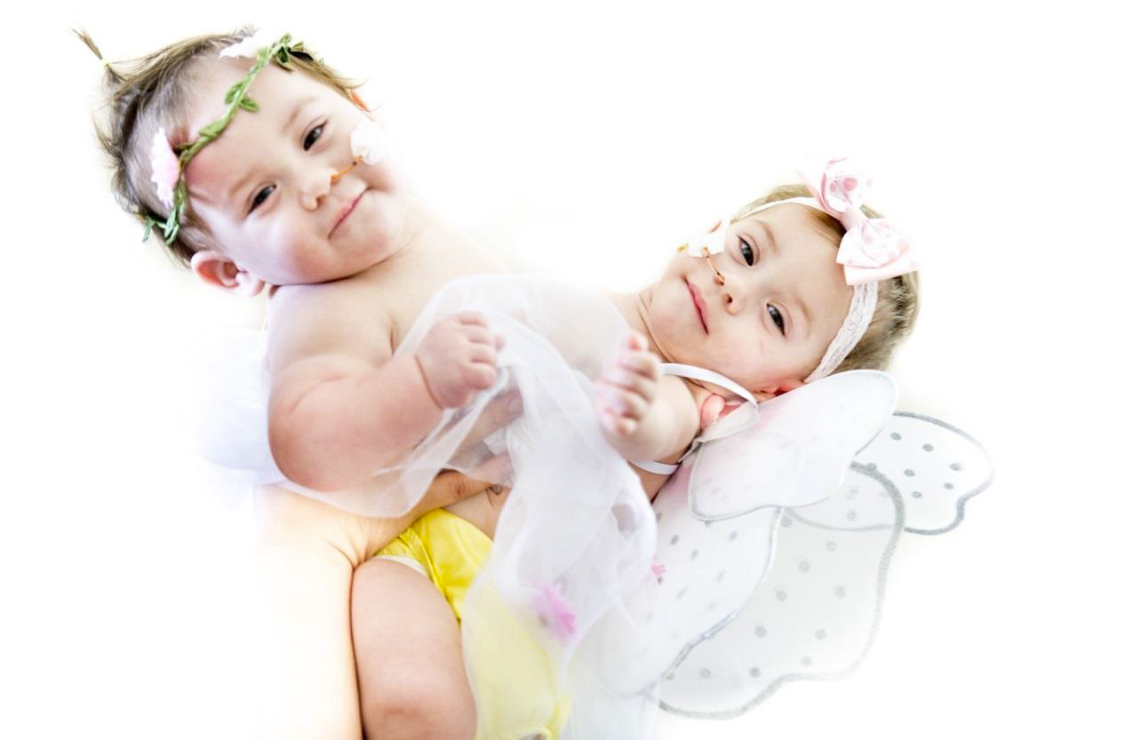 The girls at 11 months old, happy and thriving. Thank you for extending your Christian love for those you do not even know, but who through CC@S can feel the comfort of their faith.