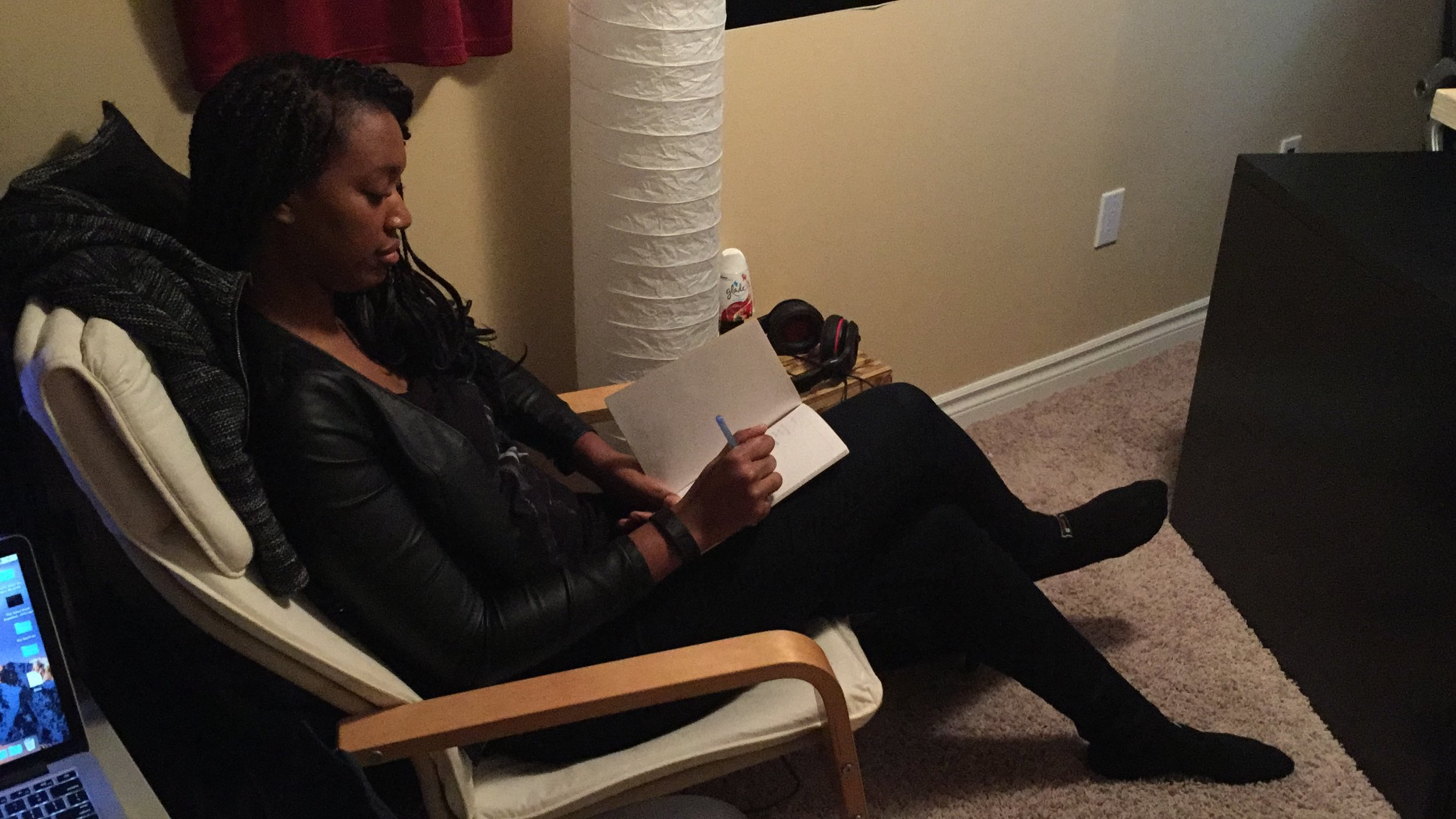 Contest winner Stacey A. puts pen to paper as she listens to a ChuBlaqa instrumental.