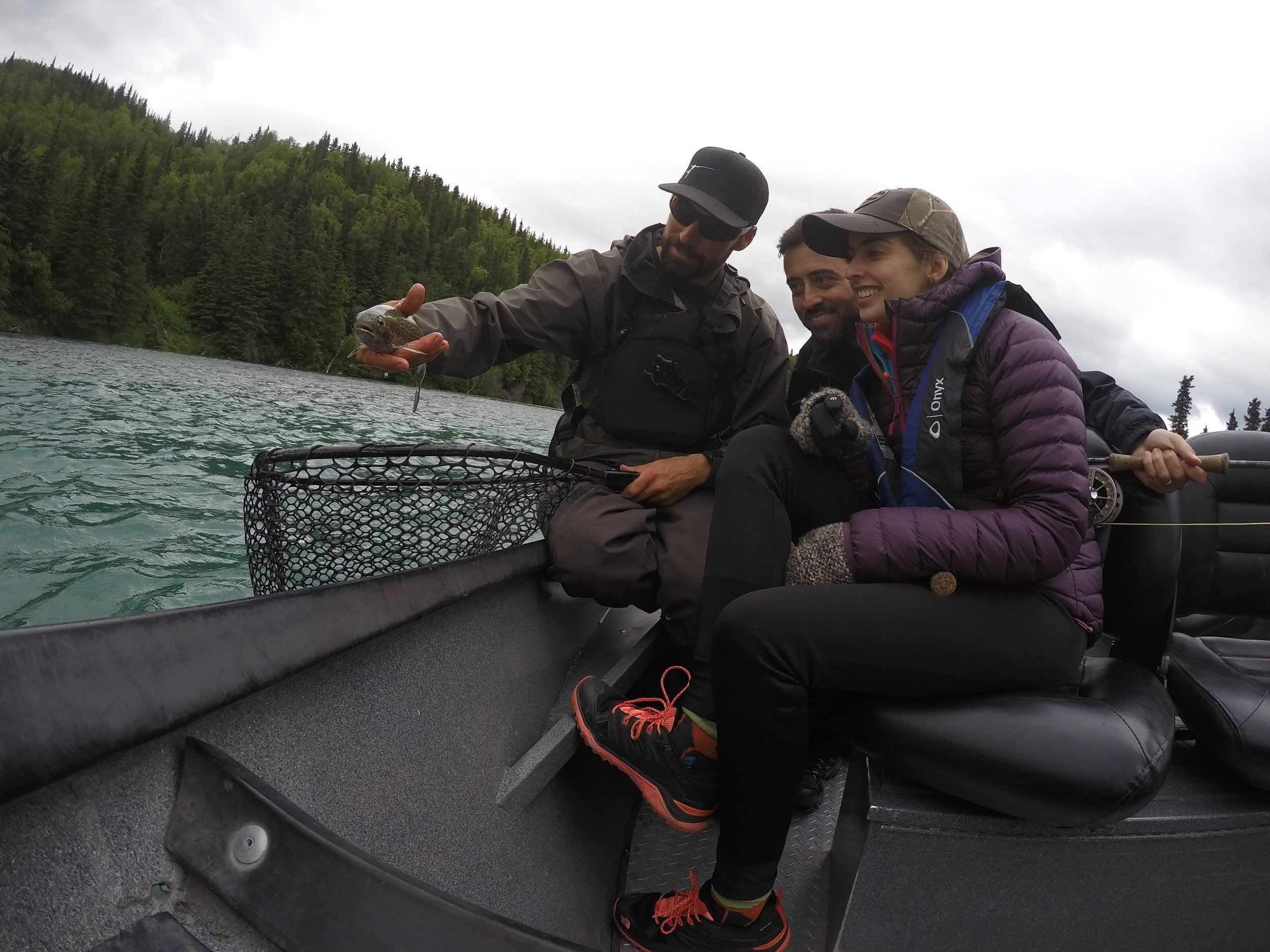 Our guests from Spain admiring a beautiful    Kenai River Rainbow    on their guided fishing trip.