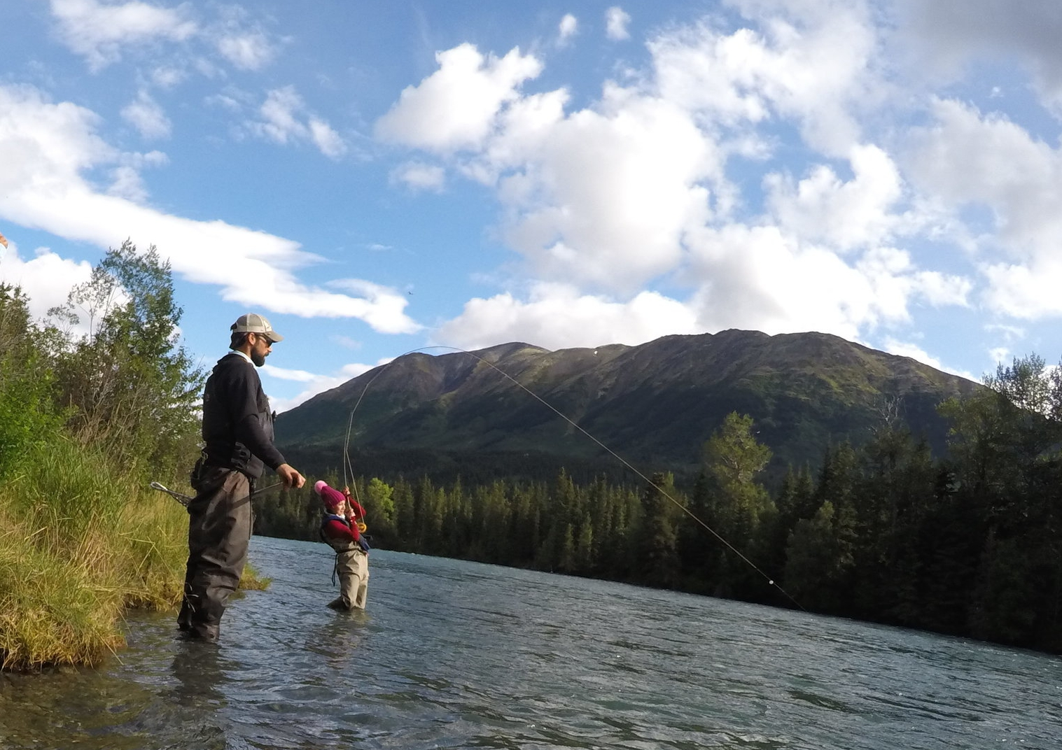 "Kai battles a big    Rainbow Trout    during the ""bead bite"" on the    Kenai River   ."