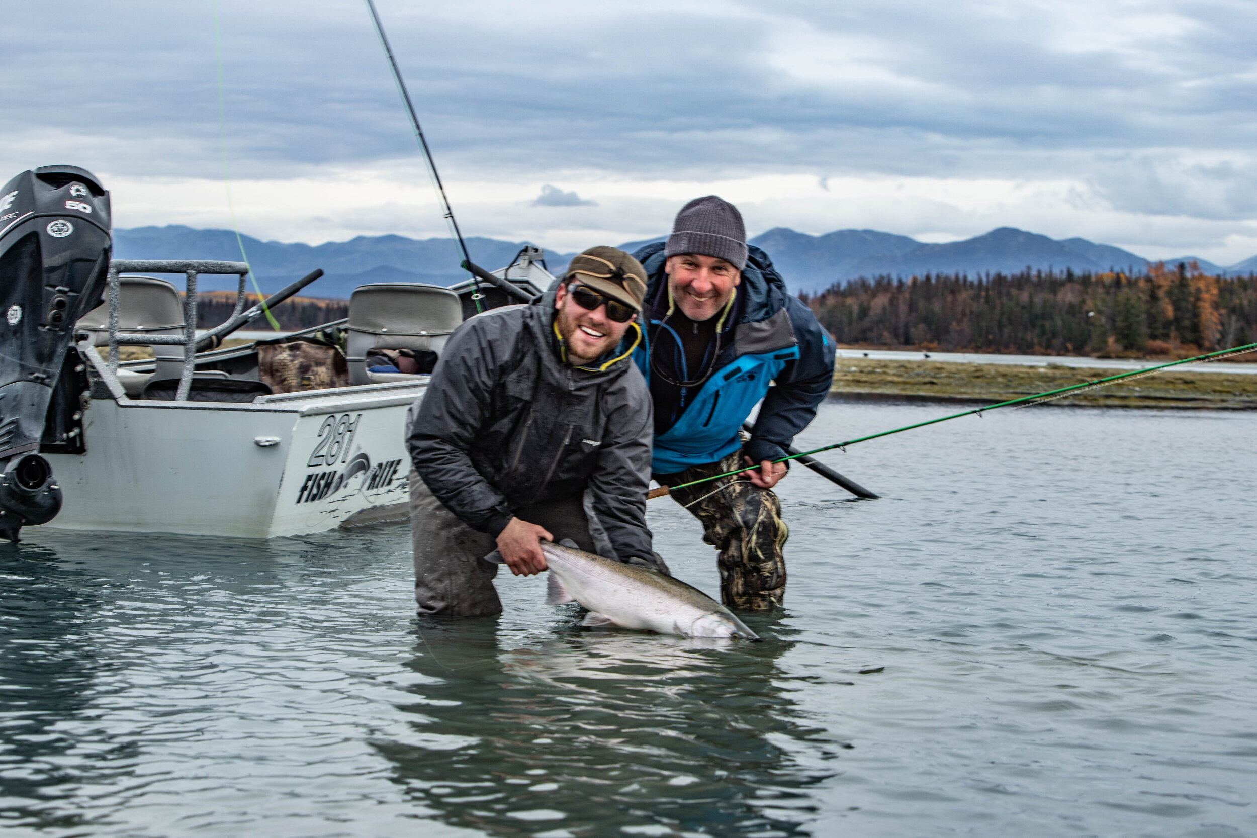 Andrew and his father with a beautiful, dime-bright    Coho Salmon    caught stripping flies on the    Kenai River    in October!