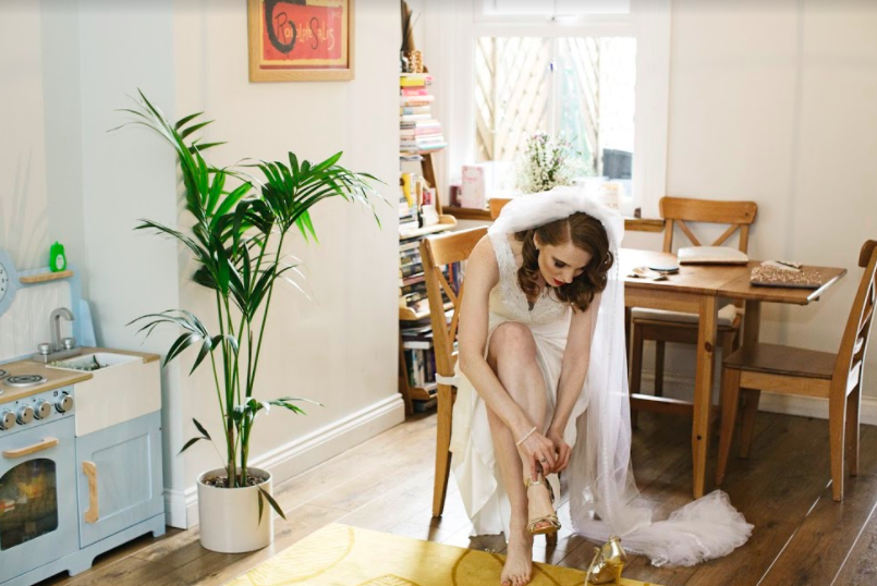 Heather WAS A VISION IN a vintage inspired dressBrowse our Bridal Iconic Collection to find a style like Heather's dress and see many more options -