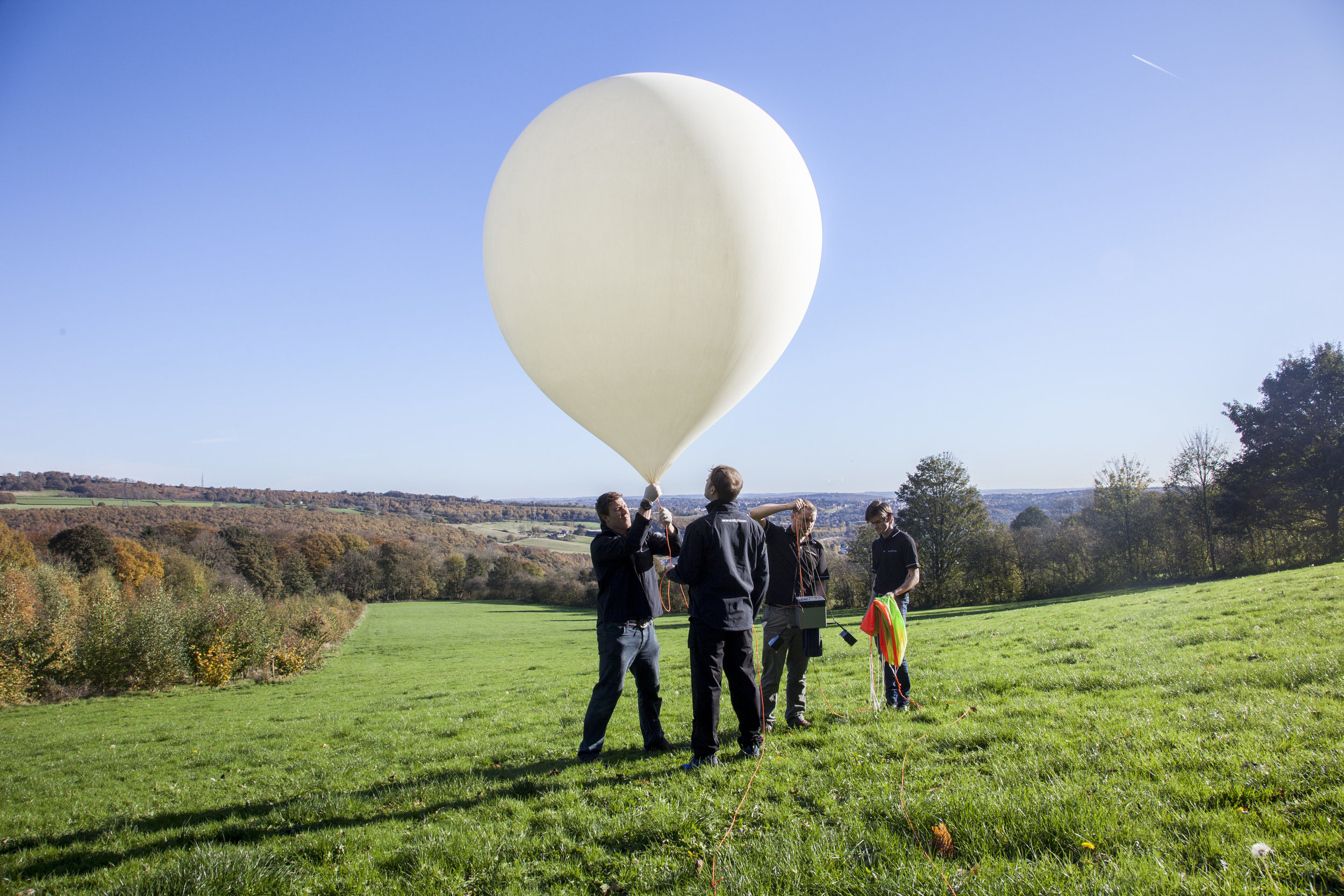 The Ascension Flights team preparing to launch a balloon which will scatter ashes in space