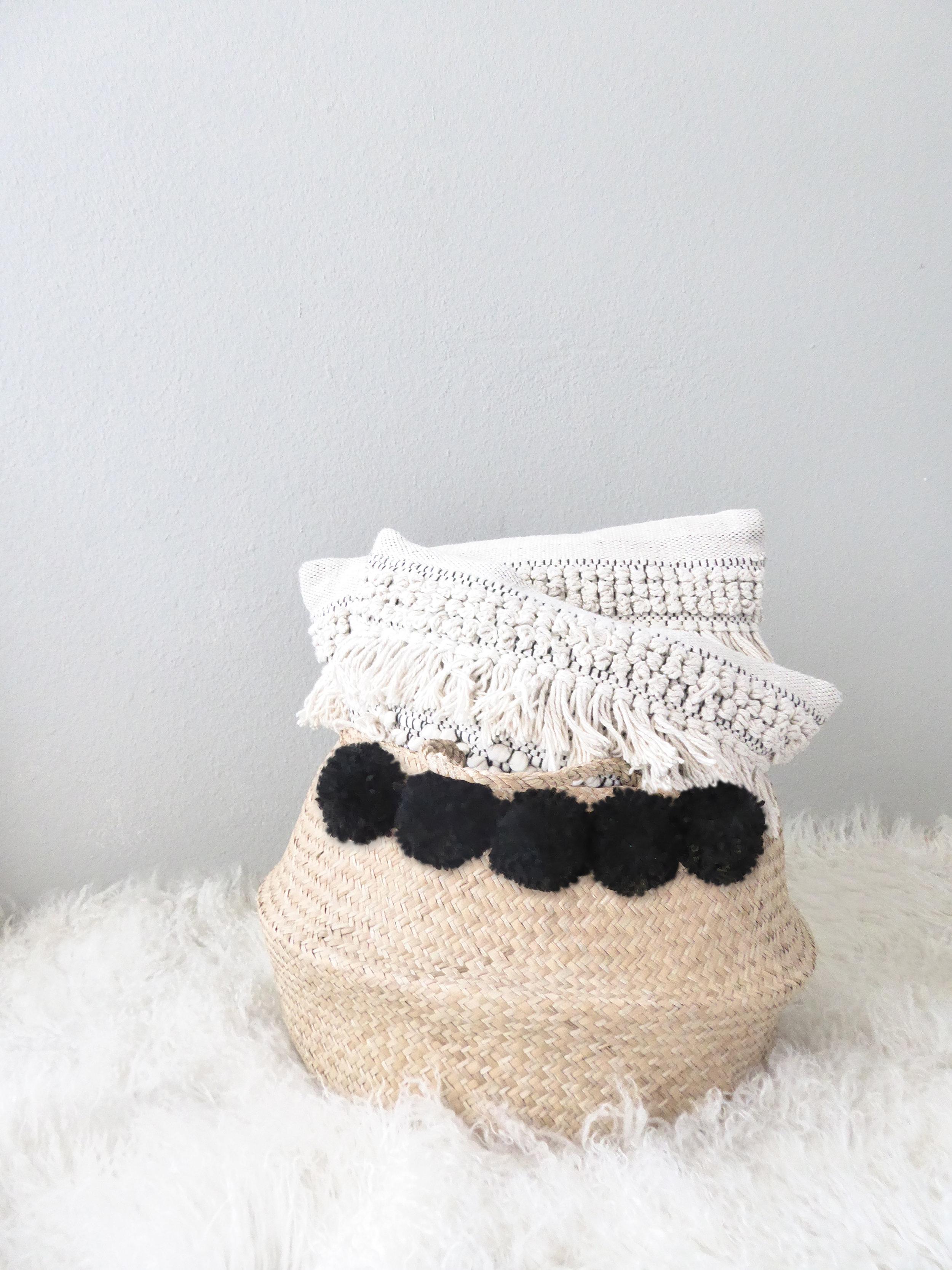 black pompom basket pillows.jpg