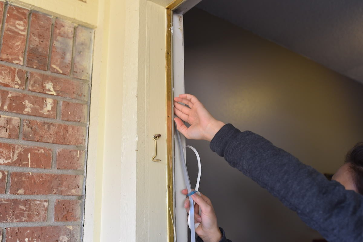 Step 3: Apply the weather stripping around the door.