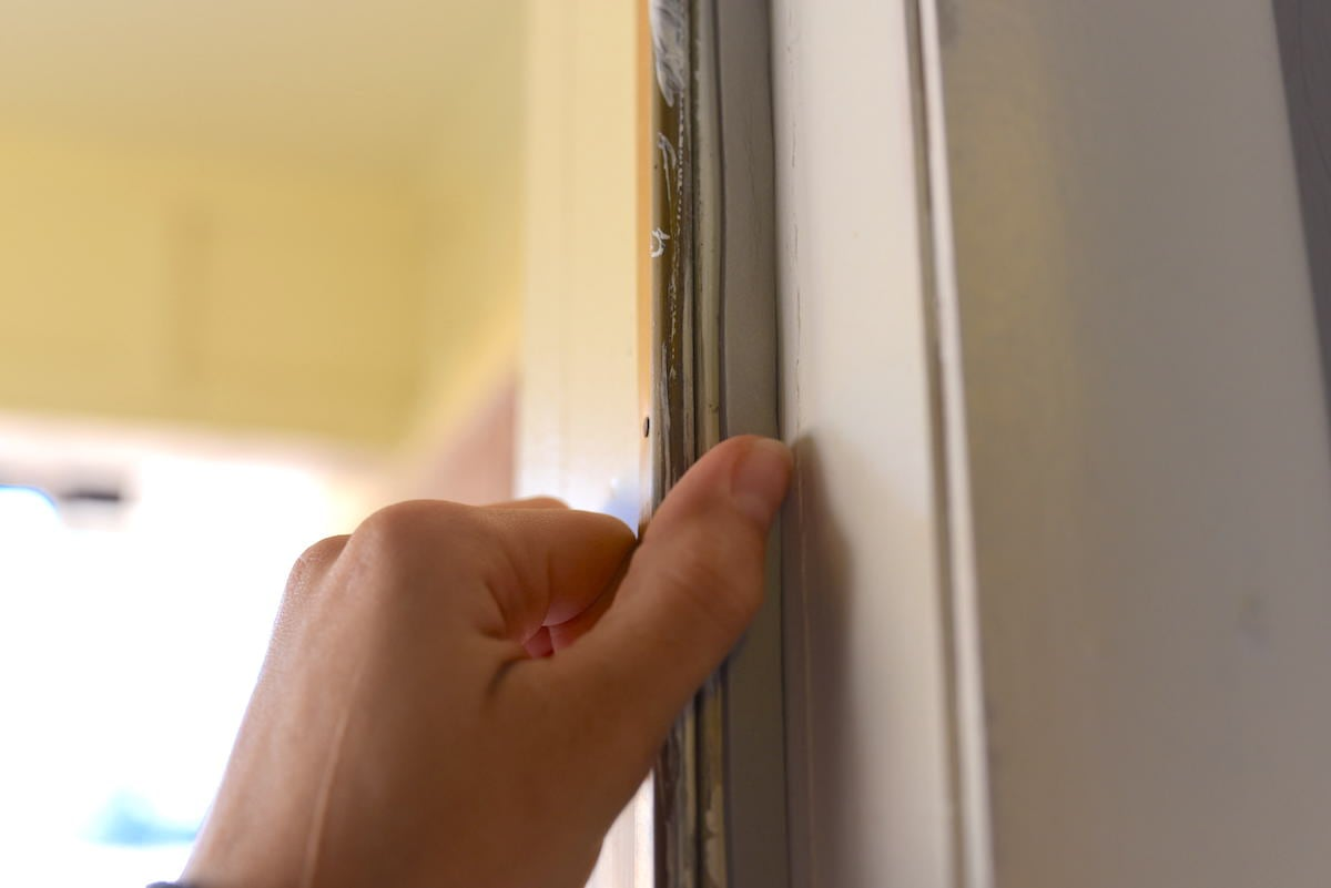 Step 4: Continue to apply around other sides of door frame.
